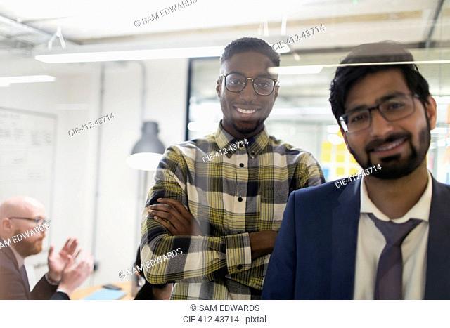 Portrait smiling, confident businessmen in office