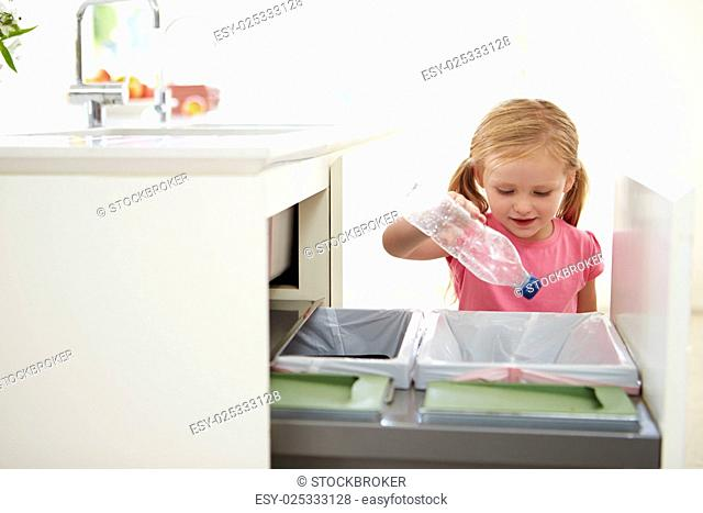 Girl Recycling Kitchen Waste In Bin