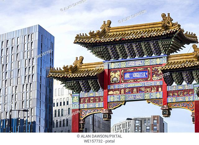 Chinatown arch in Newcastle with student accommodation in background. Newcastle upon Tyne, England, UK