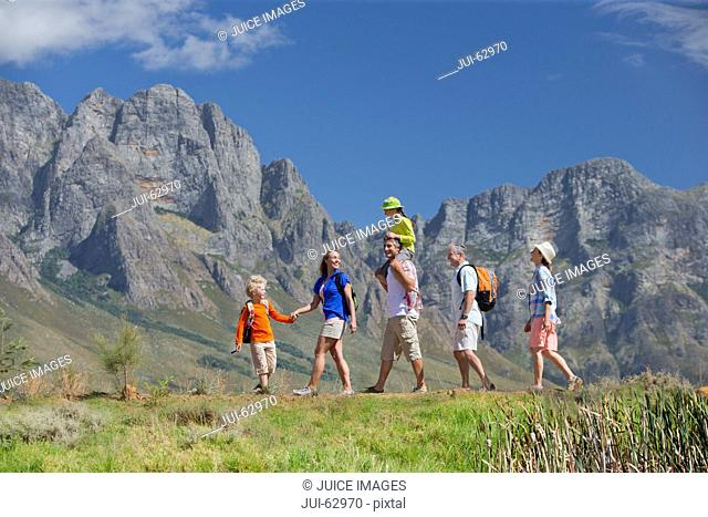 Multi generation family hiking on mountain path