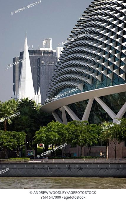 White spire of St Andrews Cathedral unusual roof Esplanade Theatres on the Bay Singapore
