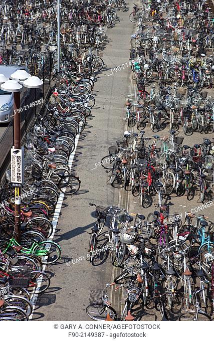 Bicycles parked at train station in Tosu, Saga, Japan