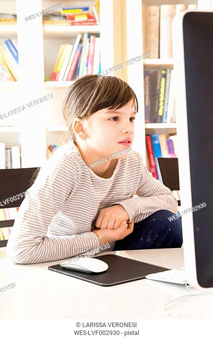 Portrait of girl spending time at computer