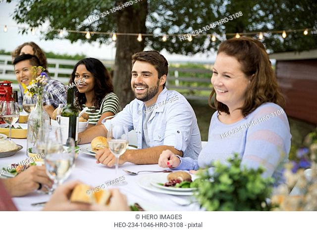 Friends gathered at outdoor dinner party