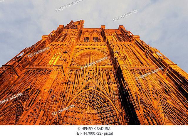 Illuminated facade of Strasbourg Minster against sky