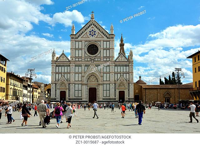 Tourists on the Piazza in front of the Basilica Santa Croce of Florence - Italy