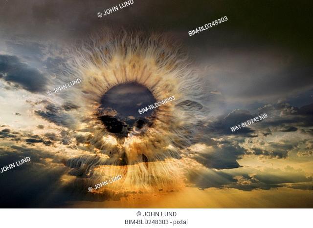Eye in cloudy sunset sky