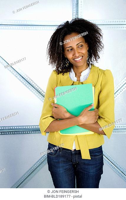 Ethiopian businesswoman holding file folders