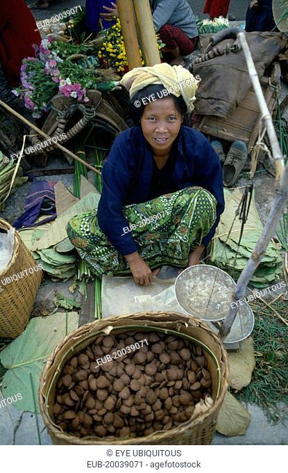 Woman selling rice cakes at street market near Inle Lake