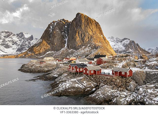 The fishing village with its traditional 'rorbus' at dawn in winter. Hamnoy, Nordland county, Northern Norway, Norway