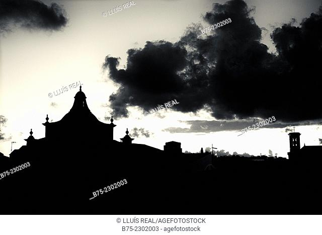 Silhouette of the steeples of the churches del Carmen and Santa Maria with clouds in the sky. Mahon, Menorca, Baleari Islands, Spain, Europe