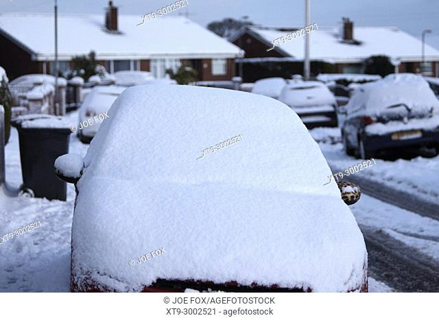 car parked on the street windscreen covered in snow in newtownabbey northern ireland