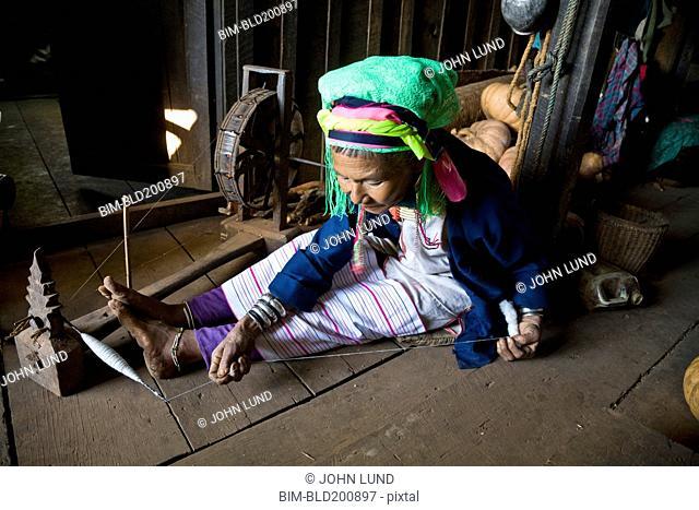 Burmese woman winding string