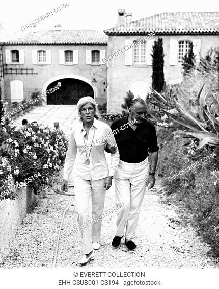 French President and Claude Pompidou enjoy a stroll on the French Riviera. Mme. Pompidou preferred modern art to politics