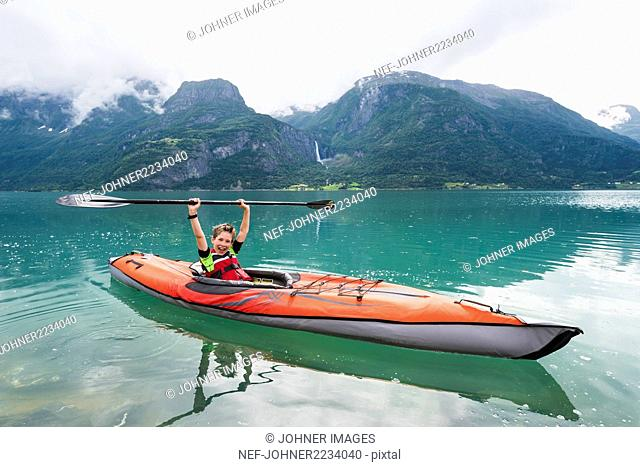 Boy sea kayaking