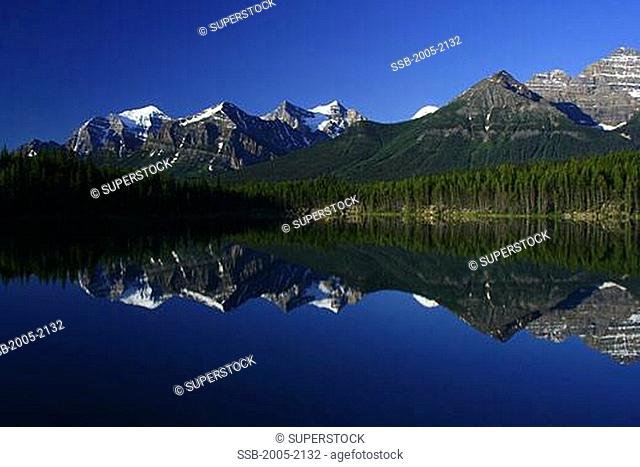 Reflection of mountains in water, Lake Herbert, Wenkchemna Peaks, Banff National Park, Alberta, Canada