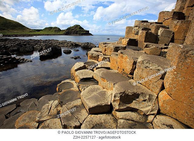 Polygonal basalt lava rock columns of the Giant's Causeway on the north coast of County Antrim, Northern Ireland, UK