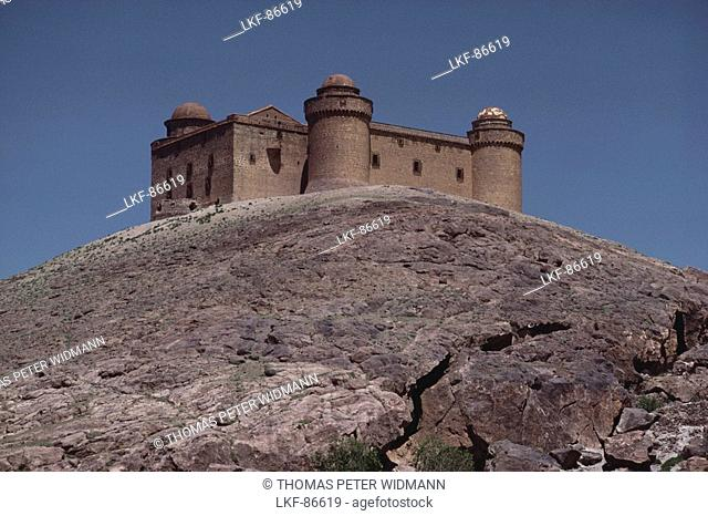 Renaissance castle of Lacalahorra on a smooth rocktop, Sierra Nevada, Granada province, Andalusia. Spain