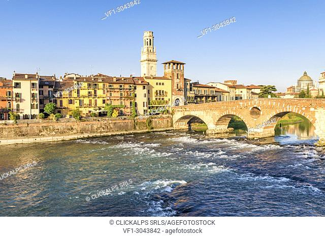 Ponte Pietra (Stone Bridge) and Verona old town at sunrise. Verona, Veneto, Italy