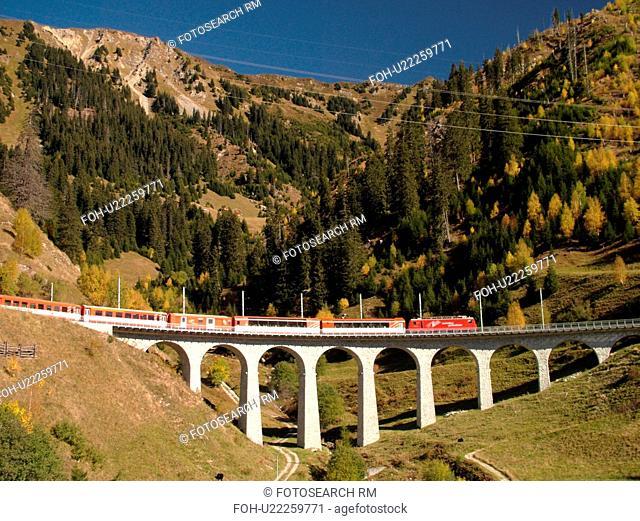 Switzerland, Europe, Sedrun, Graubunden, Grisons, railroad bridge, Matterhorn-Gotthard-Bahn Glacier Express red train