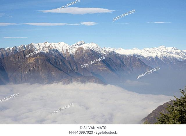 Sea of fog and with snow-capped mountain in a sunny day in Ticino, Switzerland