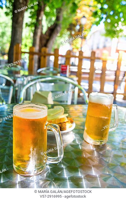 Two glasses of beer and tapa in a terrace. Spain