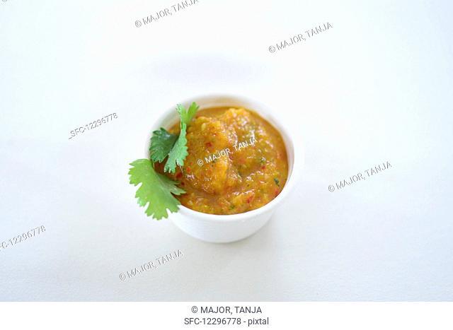 Vegetable sauce in a styrofoam bowl