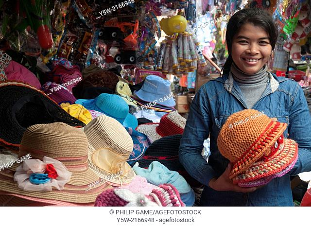 Hat seller at a Cambodian country market in Ratanakiri province