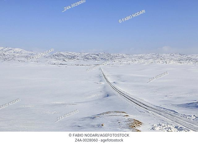 Grassland covered in ice and snow in Xinjiang, northen China