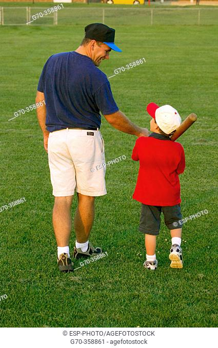 Father and son with baseball equipment