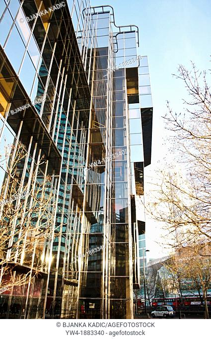 Glass building at intersection of Tottenham Court Road and Hampstead Road and Euston Road, London, UK