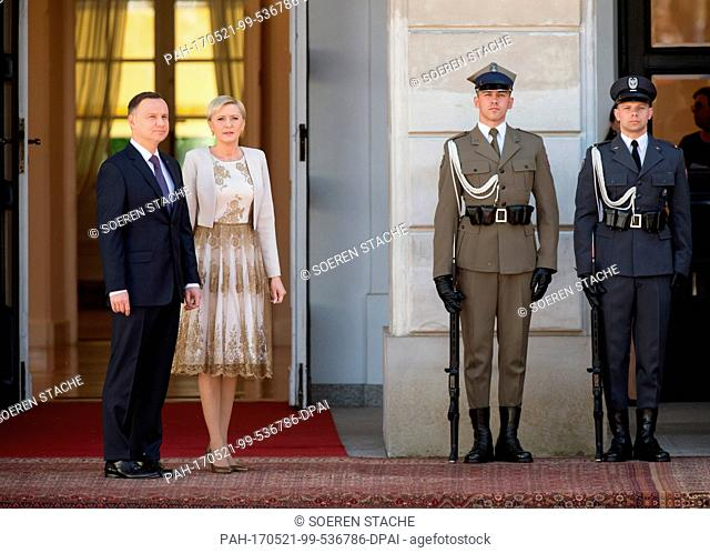 Polish President Andrzej Duda (L) and his wife Agata Kornhauser-Duda (2-L) await the arrival of German President Frank-Walter Steinmeier (not pictured) in front...