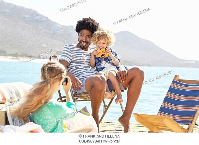 Family on houseboat deck, Kraalbaai, South Africa