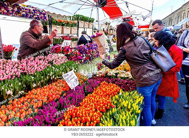 Londoners Buying Flowers At Columbia Road Flower Market, Tower Hamlets, London, England