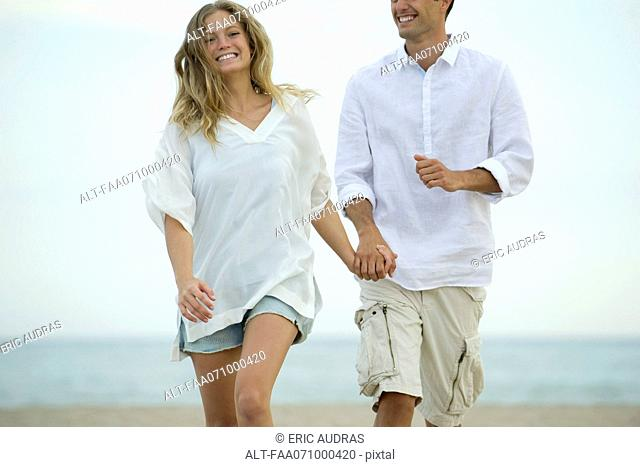 Couple walking together at the beach