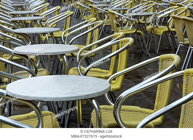 Venice, St Mark's Square, cafe, vacant tables and chairs in the rain