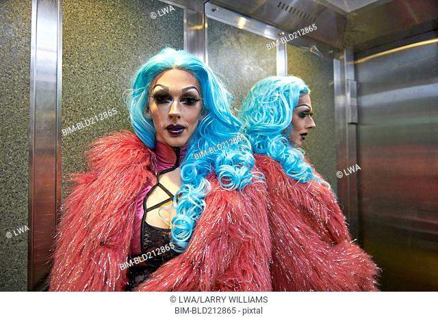 Caucasian drag queen posing in elevator