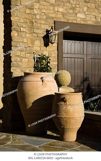 Terra cotta pots outside tuscan home