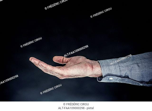 Man's extended hand, palm facing up