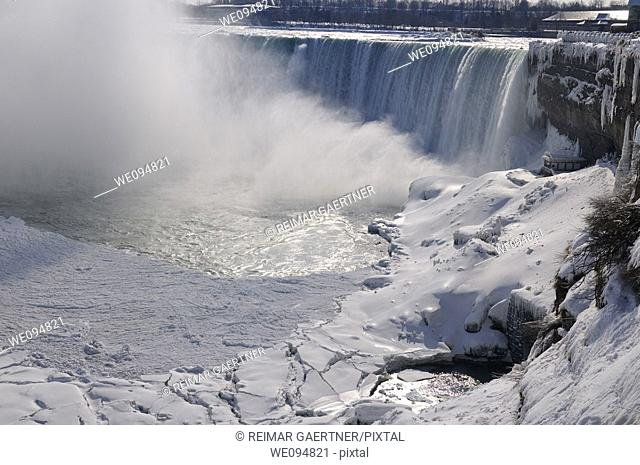 Canadian Horseshoe Falls at Niagara Falls Ontario with sheets of ice in winter