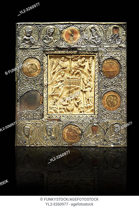 Medieval Christian relief Icon depicting scenes from the Nativity, A central ivory panel surrounded by beaten silver border