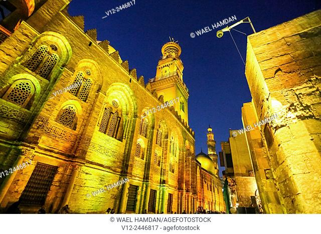 Madrasa, Mausoleum of Sultan Qalawun and sultan al-Zahir barquq Madrasa at Al-Muizz li-Din Allah Street at night, city of Cairo, Egypt