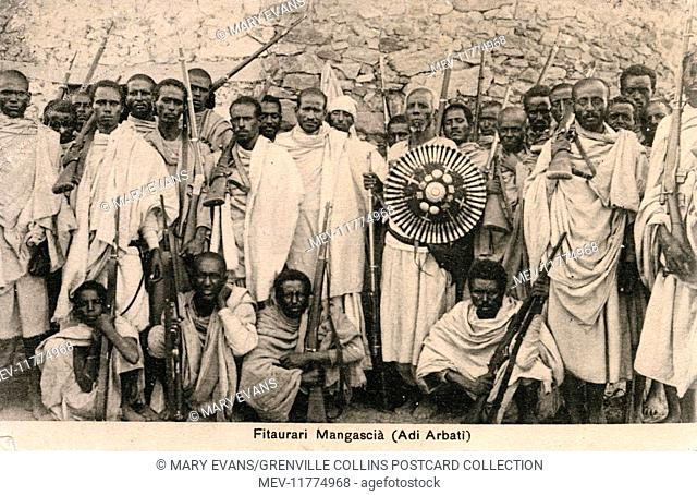 Ethiopian 'Commander of the Spearhead' Fitaurari ('General') Mangasha (with shield centre right) and his fearsome band of warriors pictured in the Arbaate...