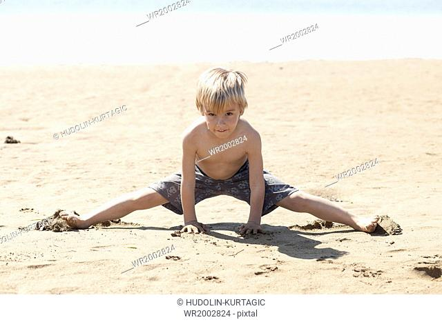 Blond boy playing on beach