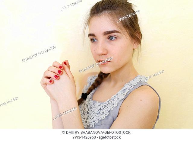 Portrait of teenage girl indoors with braid