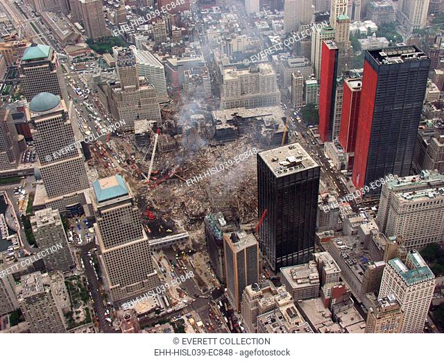 Aerial view of World Trade Center from the southwest, Sept. 27, 2001. Orange reinforcing plastic covers the street facades of severely damaged buildings on...