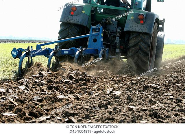 ploughing the land