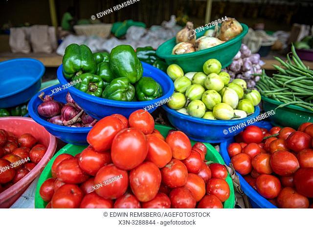 Plastic bins full of various vegetables for sale at outdoor market, Rwanda Farmers Market, in Rwanda