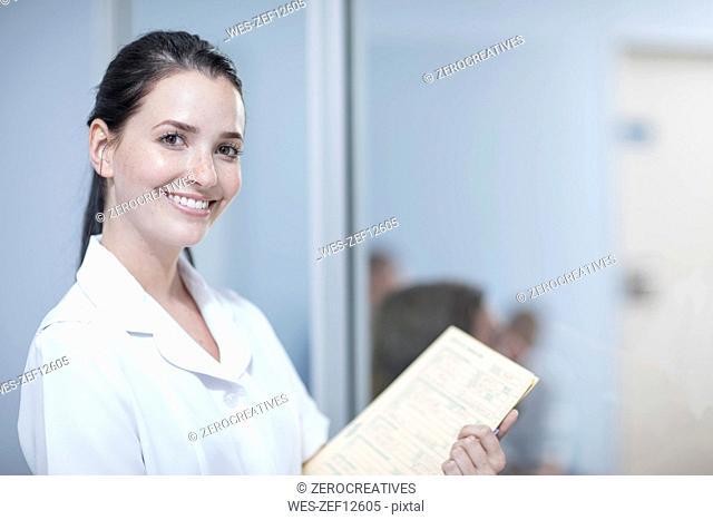 Nurse holding patient's record, portrait