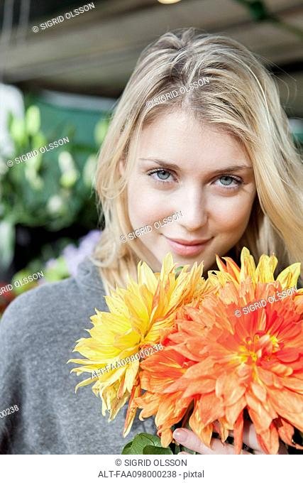Young woman with flower bouquet, portrait